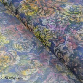 Tulle souple motif fleurs tons bleu et vers