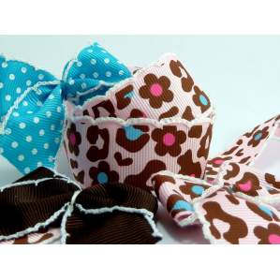 Ruban crochet gros grain rouge et rose motif léopard 25mm