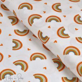 Tissu jersey pailleté coton motif arc-en -ciel - Blanc, orange et jaune - Oeko-Tex ® Autres marques - Tissus et mercerie - 1