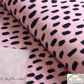 Tissu molleton gratté motif peinture - Rose et noir